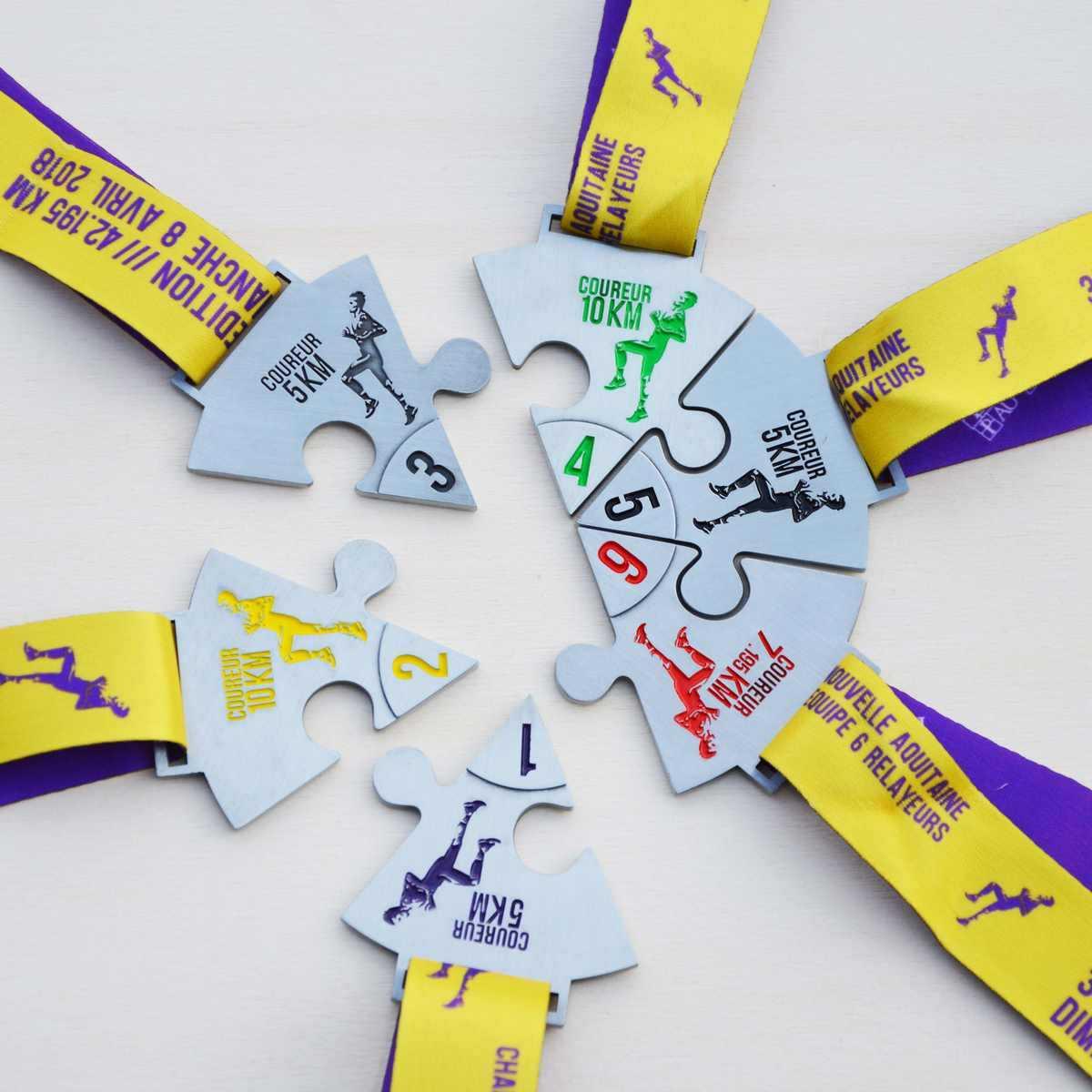 Médailles finisher Ekiden - Nouvelle aquitaine - médaille divisée en 6 pièces de puzzle afin de constituer une médaille ronde en assemblant les différents morceaux